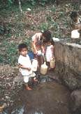 Filling jogs of water in Nicaragua - Click for info